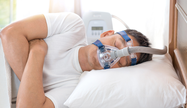 man-with-sleep-apnea-and-cpap-mask